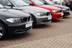 Line of luxury used cars. Row of prestige used cars for retail sale in a motor dealers yard showing same model in different colour choices Stock Photos