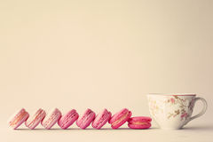 Line of macaroons. And vintage tea cup royalty free stock photography