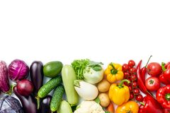 Top view of line made of different vegetables and berries on white background royalty free stock photography