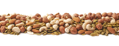 Line made of nuts and seeds isolated Royalty Free Stock Photography
