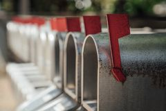 Line of mailboxes with red flags royalty free stock image