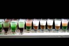 Line of many alcoholic shooters Royalty Free Stock Photo