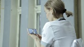 On-line medical consultations. male patient video chatting with doctor on phone stock footage