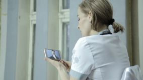 On-line medical consultations. male patient video chatting with doctor on phone stock video