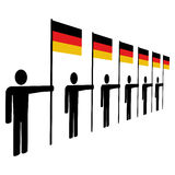 Line of men with German flags Royalty Free Stock Image