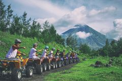Line Of Men Riding On All Terrain Vehicles Holding Out Hand In A Fist Royalty Free Stock Images