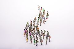 Line of miniature people view from above, over white. Line of miniature people view from above, over white background Stock Photo