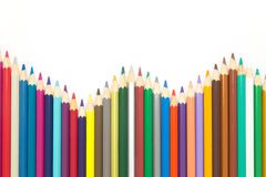 Line of mixed colors wooden pencils, on white bakground Stock Photo