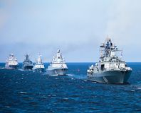 A line of modern russian military naval battleships warships in the row, northern fleet and baltic sea fleet in the open sea Royalty Free Stock Images