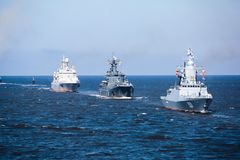 A line of modern russian military naval battleships warships in the row, northern fleet and baltic sea fleet in the open sea Stock Photos