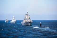 A line of modern russian military naval battleships warships in the row, northern fleet and baltic sea fleet in the open sea Stock Photography