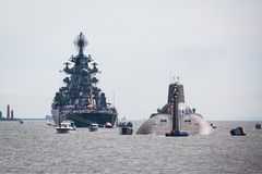 A line of modern russian military naval battleships warships in the row, northern fleet and baltic sea fleet in the open sea Stock Images