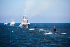 A line of modern russian military naval battleships warships in the row, northern fleet and baltic sea fleet in the open sea Royalty Free Stock Photo