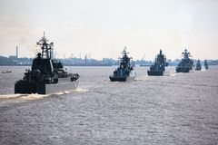A line of modern russian military naval battleships warships in the row, northern fleet and baltic sea fleet in the open sea Royalty Free Stock Image