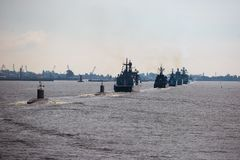 A line of modern russian military naval battleships warships in the row, northern fleet and baltic sea fleet in the open sea Stock Image