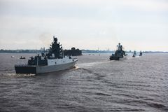 A line of modern russian military naval battleships warships in the row, northern fleet and baltic sea fleet in the open sea Royalty Free Stock Photography