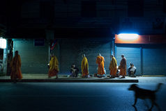 Line of monks collect morning alms Stock Images