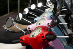 A line of mopeds/scooters Royalty Free Stock Photos