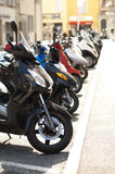 A line of mopeds/scooters Royalty Free Stock Images