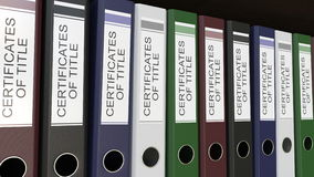 Line of multicolor office binders with Certicicates of title tags 3D rendering. Line of multicolor office binders with Certicicates of title tags Royalty Free Stock Photos