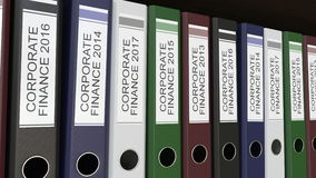 Line of multicolor office binders with Corporate finance tags different years. Line of multicolor office binders with Corporate finance tags, different years. 4K vector illustration