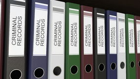 Line of multicolor office binders with Criminal records tags. 4K seamless loop clip