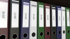Line of multicolor office binders with 2013 - 2017 year tags 3D rendering. Line of multicolor office binders with 2013 - 2017 year tags stock illustration