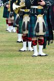 Line of musicians in Kilts. Line of musicians in long Kilts stock photography