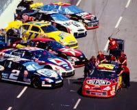 Line of NASCAR vehicles. Stock Photos