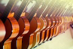 Line of new acoustic guitars in store Royalty Free Stock Photography