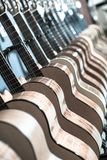 Line of new acoustic guitars in store. Line of new wood acoustic guitars in store Stock Image