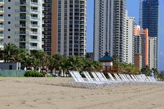 Line Of High Rises And Lounge Chairs Along The Beach Royalty Free Stock Photo