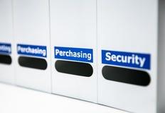 Line of office folders. Selective focus purchasing folder Stock Image
