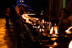 Line of oil candle. Light oil candle up in the temple show traditional culture of myanmar buddhistsm Stock Images