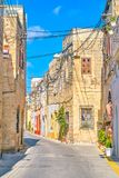 The residential houses in Naxxar, Malta. The line of old limestone residential buildings in historical neighborhood of Naxxar, Malta royalty free stock photo