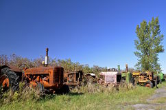 Line of old rusty tractors Stock Photos