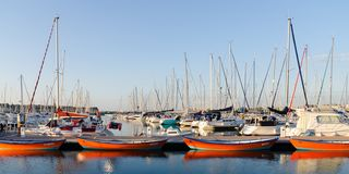 Line of orange boats in Saint-Malo harbour royalty free stock photography