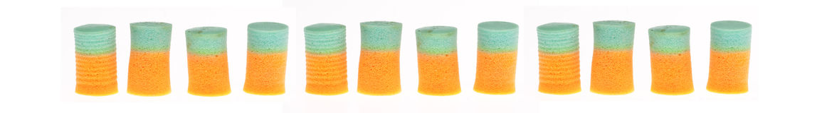 Line of Orange and Green Ear Plugs Royalty Free Stock Images