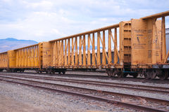 Line of orange rail cars royalty free stock photos