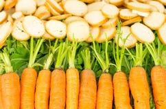 Line of organic carrots beautiful orange and green stock photos