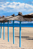 Line of Parasols at Spanish Sand Beach Stock Photos