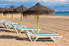 Line of Parasols at Spanish Sand Beach Stock Photography