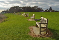 A Line of park benches. Felixstowe Suffolk Stock Photography