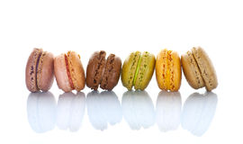 Line of pastel colored french macarons, on white Stock Photography