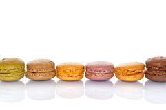 Line of pastel colored french macarons Stock Photos