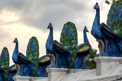 A line of peacock statues line the main courtyard at the Kataragama temple in southern Sri Lanka near Tissamaharama. Stock Images