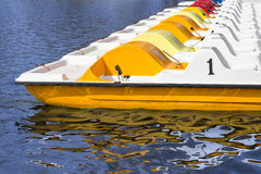 Line of pedal boats on a pier,  row of boats Royalty Free Stock Photos