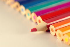 Line of pencils with one individual Stock Photography