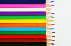 Line of pencils on white paper Royalty Free Stock Image