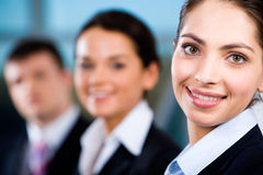 Line of people. Line of business people�s faces with beautiful woman in front stock photos